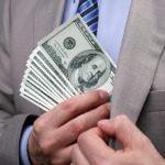 man-putting-money-in-suit-jack-568242741-825x510